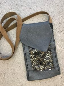 Gray and gold hand stitched leather bag